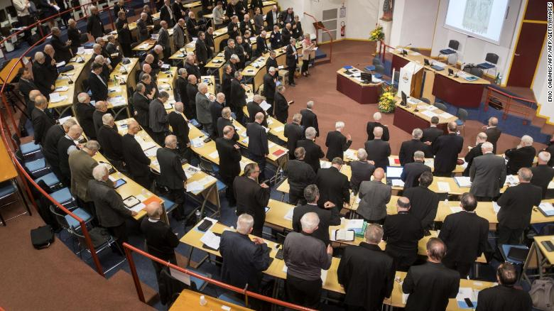 French bishops stand in prayer at the opening of the French Bishops Conference (CEF) annual conference at the Sanctuaires de Lourdes on November 3.