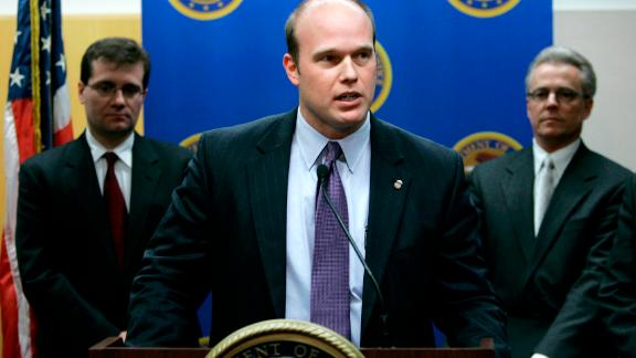 U.S. Attorney Matthew Whitaker speaks during a news conference as James Vandenberg, Office of Inspector General for the Dept. of Labor, left, and Iowa state Auditor David Vaudt, right, look on, Tuesday, Jan. 16, 2007, in Des Moines, Iowa.  A federal grand jury on Tuesday returned a 27-count indictment against five people in a Des Moines area job training agency pay scandal.