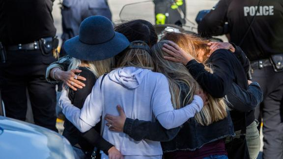 Friends hug outside the Los Robles Medical Center in Thousands Oaks, California on November 8, 2018, as they pay tribute to Ventura Country sheriff Sgt. Ron Helus who was killed in a shooting at Borderline Bar the night before. - The gunman who killed 12 people in a crowded California country music bar has been identified as 28-year-old Ian David Long, a former Marine, the local sheriff said Thursday. The suspect, who was armed with a .45-caliber handgun, was found deceased at the Borderline Bar and Grill, the scene of the shooting in the city of Thousand Oaks northwest of downtown Los Angeles.