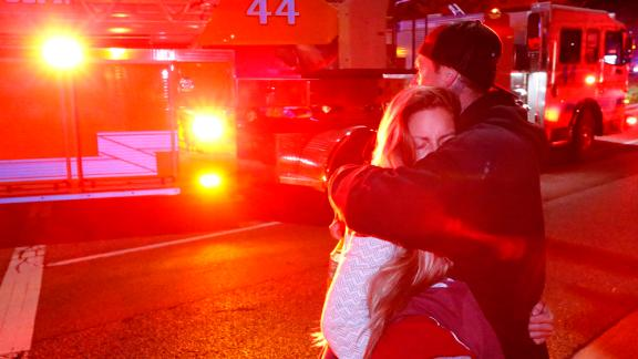 Molly Esterline is hugged by David Crawford on the scene of a shooting at a bar in Thousand Oaks, California, on Thursday, November 8.