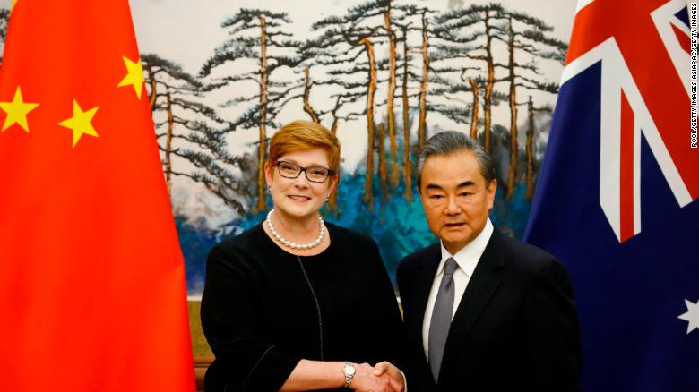Australian Foreign Minister Marise Payne and Chinese Foreign Minister Wang Yi shake hands at a news conference at the Diaoyutai State Guesthouse in Beijing Thursday.
