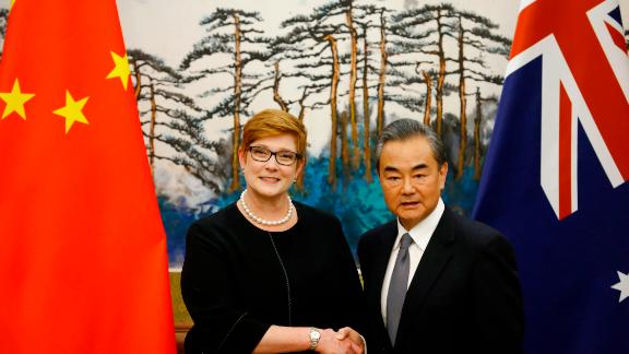BEIJING, CHINA - NOVEMBER 08: Australian Foreign Minister Marise Payne and Chinese Foreign Minister Wang Yi shake hands at a news conference at the Diaoyutai State Guesthouse on November 8, 2018 in Beijing, China. (Photo by Thomas Peter-Pool/Getty Images)