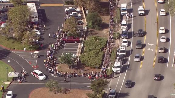Hundreds of people wait in line to give blood at La Reina High School in Thousand Oaks, California, on Thursday after a gunman walked into the Borderline Bar and Grill and killed 12 people.