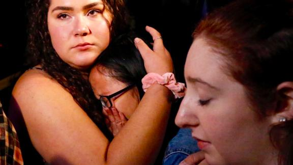 THOUSAND OAKS, CA - NOVEMBER 08:  Nellie Wong cries as Chyann Worrell holds her and Erika Sigman (R) were all inside when shooting started inside the Borderline Bar & Grill when a shooter wounded seven Wednesday night on November 8, 2018 in Thousand Oaks, California. The gunman burst into the bar around 11:20 p.m., cloaked in all black as he threw smoke bombs and began shooting at targets as young as 18 inside the Borderline Bar & Grill, authorities and witnesses said. (Photo by Al Seib / Los Angeles Times via Getty Images)
