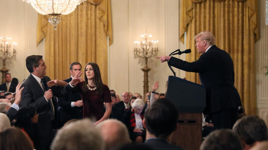 "A White House staff member reaches for the microphone held by CNN's Jim Acosta as he questions Trump during a news conference on Wednesday, November 7. Later that day, in a stunning break with protocol, the White House said that it was <a href=""https://www.cnn.com/2018/11/07/media/trump-cnn-press-conference/index.html"" target=""_blank"">suspending Acosta's press pass</a> ""until further notice."""