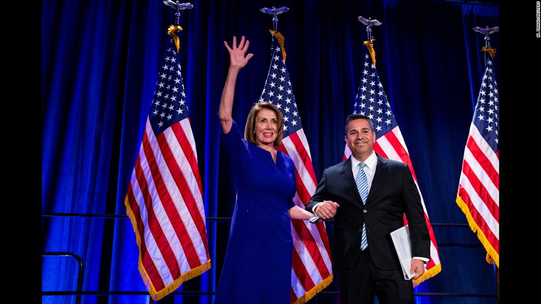 "House Minority Leader Nancy Pelosi is introduced on stage by Democratic Congressional Campaign Committee Chairman Ben Ray Lujan as they react to the results of <a href=""https://www.cnn.com/2018/11/05/politics/gallery/america-votes-2018/index.html"" target=""_blank"">the midterm elections</a> on Tuesday, November 6. The Democratic Party will regain control of the US House of Representatives for the first time in eight years, CNN projects, but the Republican Party will hold onto control of the US Senate."
