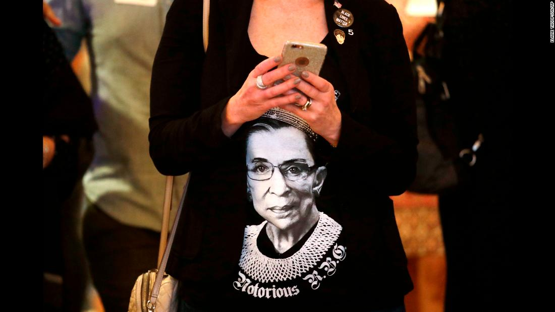 "While attending an election-night party in Bellevue, Washington, Laura Taylor wears a shirt with the likeness of US Supreme Court justice Ruth Bader Ginsburg. Ginsburg, 85, <a href=""https://www.cnn.com/2018/11/08/politics/ruth-bader-ginsburg-fractured-ribs-hospitalized/index.html"" target=""_blank"">fractured three ribs this week</a> after falling in her office."