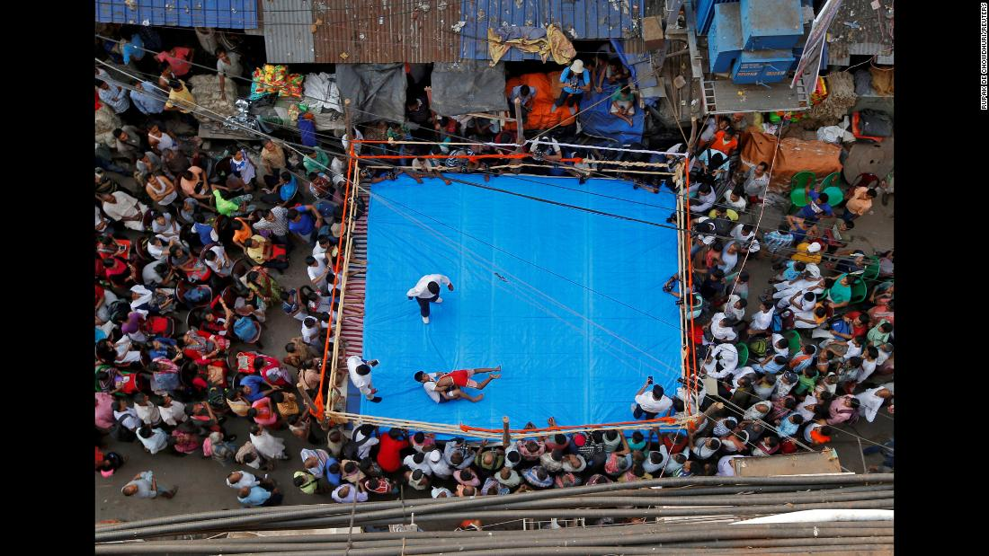 Amateur wrestlers compete in a roadside ring in Kolkata, India, as part of the Diwali festival on Monday, November 5.