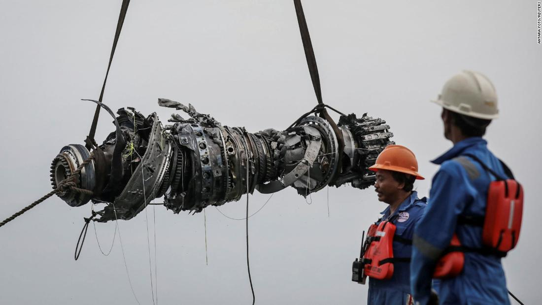 "A turbine engine belonging to Lion Air Flight JT 610 is lifted in Karawang, Indonesia, on Saturday, November 3. The passenger plane was carrying 189 people <a href=""https://www.cnn.com/2018/10/29/asia/gallery/indonesia-lion-air-plane-crash-intl/index.html"" target=""_blank"">when it crashed into the Java Sea last month.</a>"