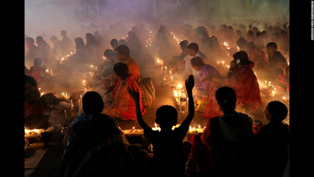 Hindu devotees sit together on the floor of a temple in Narayanganj, Bangladesh, to observe the Rakher Upabash festival on Saturday, November 3.