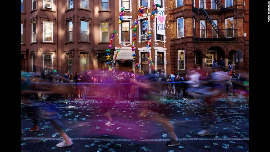 In this photo, taken with a slow shutter speed, runners race through Brooklyn during the New York City Marathon on Sunday, November 4.