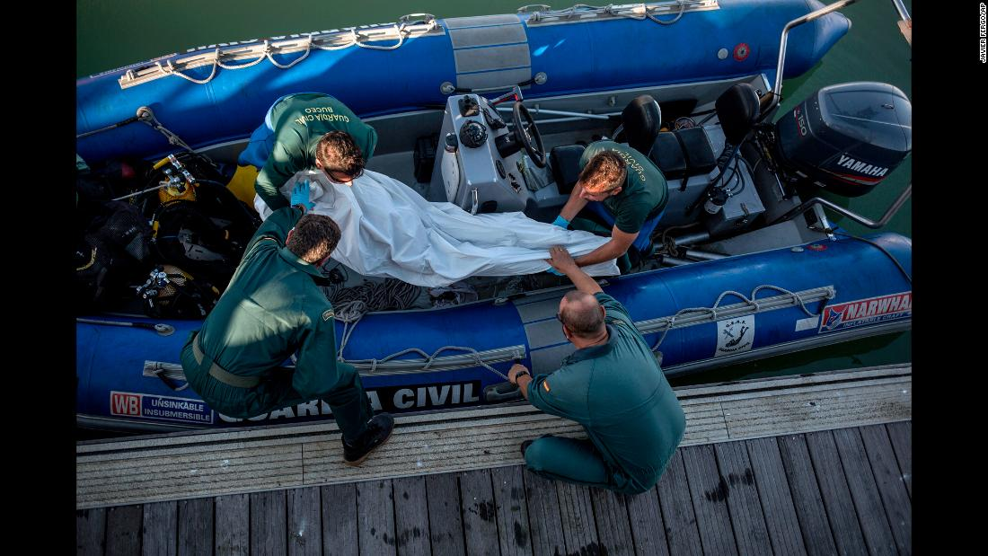 "Members of the Spanish Civil Guard carry a migrant's corpse after it was recovered off the coast of Barbate, Spain, on Tuesday, November 6. <a href=""http://www.cnn.com/2015/09/03/world/gallery/europes-refugee-crisis/index.html"" target=""_blank"">Europe's migration crisis in 25 photos</a>"
