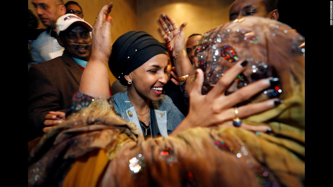 "Democratic congressional candidate Ilhan Omar is greeted by her husband's mother at an election-night party in Minneapolis on Tuesday, November 6. Omar and Michigan's Rashida Tlaib won their races to become <a href=""https://www.cnn.com/2018/11/06/politics/first-muslim-women-congress/index.html"" target=""_blank"">the first Muslim women elected to the US Congress.</a>"