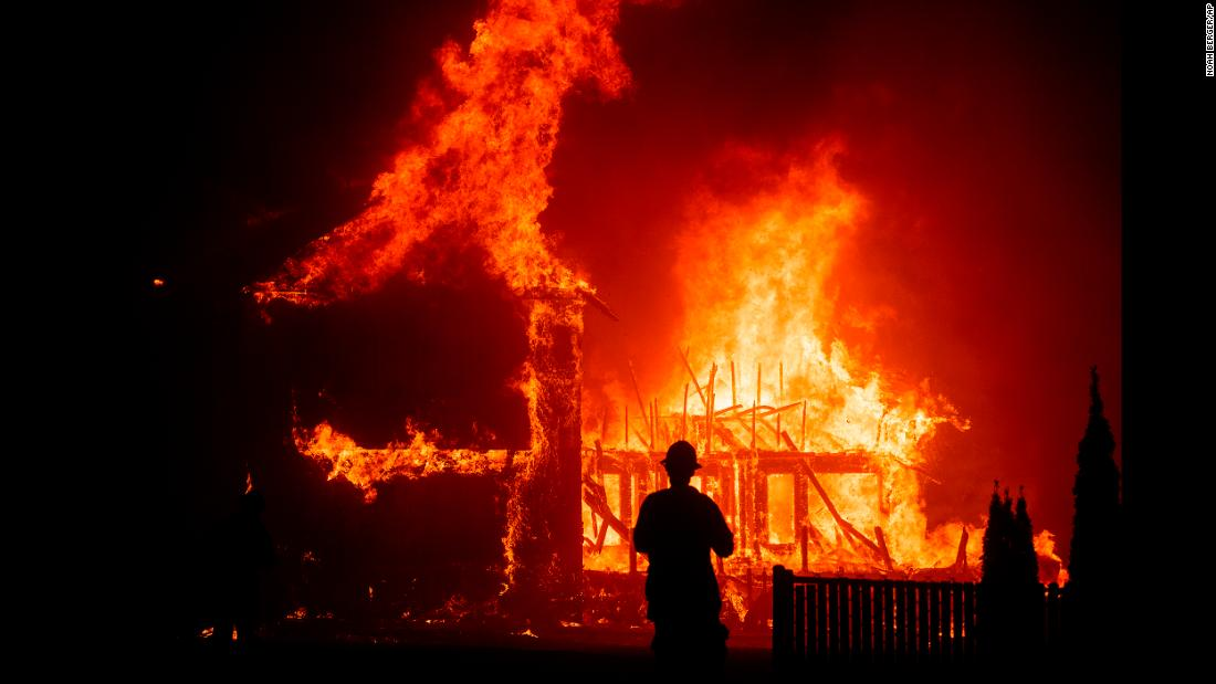 "A home burns as the Camp Fire rages through Paradise, California, on Thursday, November 8. A state of emergency has been declared for Butte County due to <a href=""https://www.cnn.com/2018/11/08/us/california-camp-fire-hospital-evacuation/index.html"" target=""_blank"">the effects of the wildfire,</a> which began around 6:30 a.m. Thursday and quickly spread."