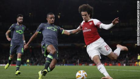 Sporting's Portuguese forward Carlos Mane vies for the ball with Arsenal's French midfielder Matteo Guendouzi.