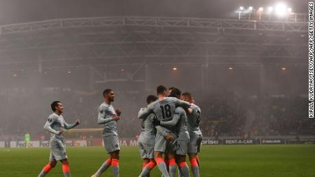 Chelsea's French striker Olivier Giroud celebrates with teammates after scoring during the Londoner's encounter with BATE Borisov outside Minsk.