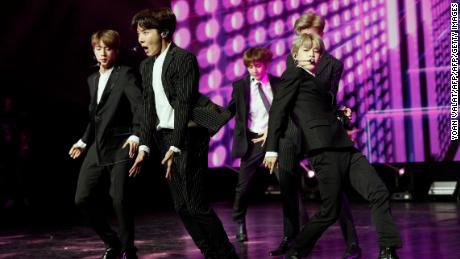 TOPSHOT - South Korean pop group BTS performs during a Korean cultural event as part of South Korean president official visit to France, on October 14, 2018 in Paris. (Photo by YOAN VALAT / POOL / AFP)        (Photo credit should read YOAN VALAT/AFP/Getty Images)