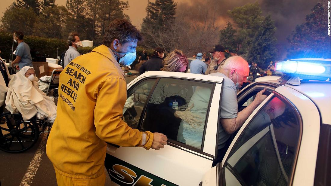 Hospital staff and first responders evacuate patients from the Feather River Hospital in Paradise on November 8.
