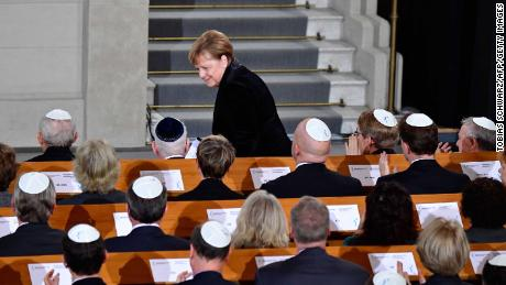 Merkel takes her seat again after speaking the Rykestrasse Synagogue in Berlin on Friday.