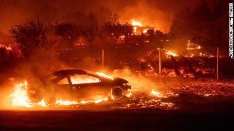 Vehicles and homes burn as the Camp Fire tears through Paradise, California on November 8.