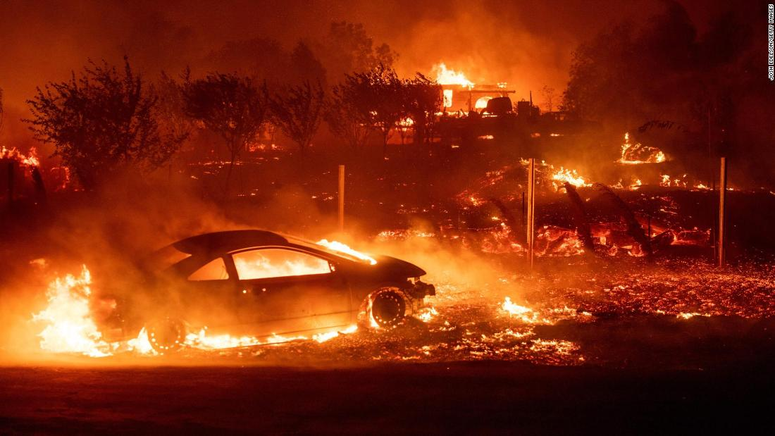 Vehicles and homes burn as the Camp Fire rips through Paradise, California, on Thursday, November 8. A state of emergency has been declared in Butte County, where thousands have been forced to evacuate.