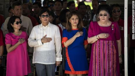 "Ferdinand ""Bongbong"" Marcos Jr, former senator and son of the late Philippines dictator Ferdinand Marcos, his sister Imee and their mother, former first lady Imelda Marcos, listen to the national anthem during a wreath-laying ceremony at a monument to the late dictator during celebrations to mark his 100th birthday in Ilocos Norte province in 2017."