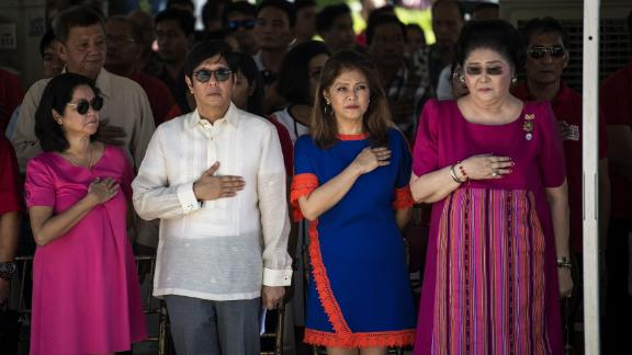 """Ferdinand """"Bongbong"""" Marcos Jr, former senator and son of the late Philippines dictator Ferdinand Marcos, his sister Imee and their mother, former first lady Imelda Marcos, listen to the national anthem during a wreath-laying ceremony at a monument to the late dictator during celebrations to mark his 100th birthday in Ilocos Norte province in 2017."""