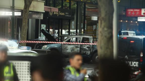 MELBOURNE, AUSTRALIA - NOVEMBER 09: A burnt out car is seen in Bourke St on November 09, 2018 in Melbourne, Australia. A man has been shot by police after setting his car on fire and stabbing several people in Bourke St mall in Melbourne's CBD this afternoon. The man was arrested at the scene and has been taken to hospital under police guard in a critical condition. (Photo by Robert Cianflone/Getty Images)