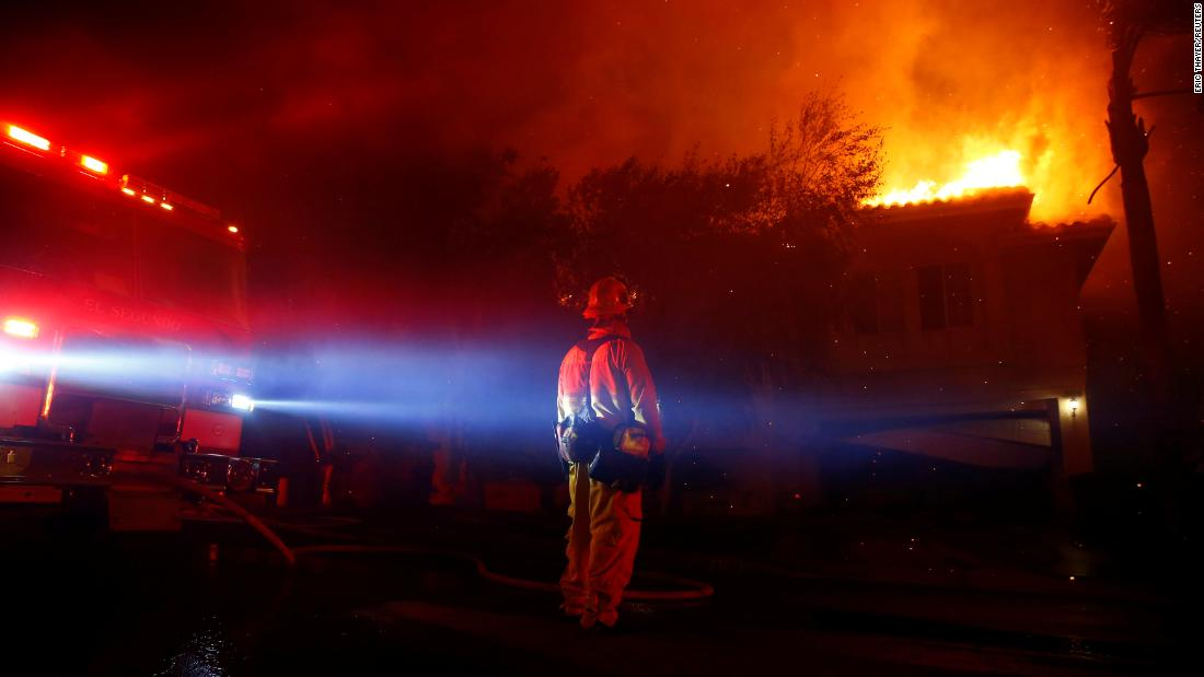 Firefighters battle flames in Thousand Oaks early November 9.