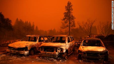Cars destroyed by the Camp Fire sit in the lot at a used car dealership on November 9, 2018 in Paradise, California.