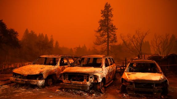 Cars destroyed by the Camp Fire sit in a used-car lot in Paradise on November 9.