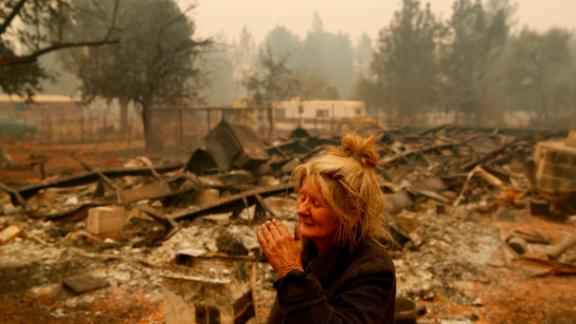 Cathy Fallon stands near the charred remains of her Paradise home on November 9. The Camp Fire has wiped out much of the town north of Sacramento.