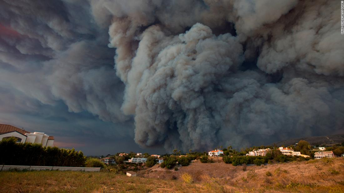 A massive smoke plume, powered by strong winds, rises above the Woolsey Fire in Malibu on November 9.