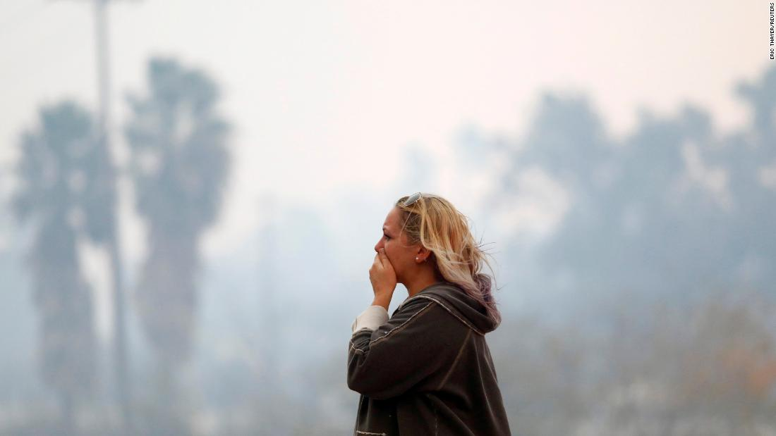 A woman reacts to devastation of the Woolsey Fire in Malibu on November 9.