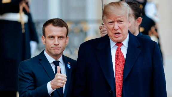 French President Emmanuel Macron, left, poses with President Donald Trump prior to their meeting at the Elysee presidential palace, in Paris, Saturday, Nov. 10, 2018. Trump is joining other world leaders at centennial commemorations in Paris this weekend to mark the end of World War I. (AP Photo/Kamil Zihnioglu)