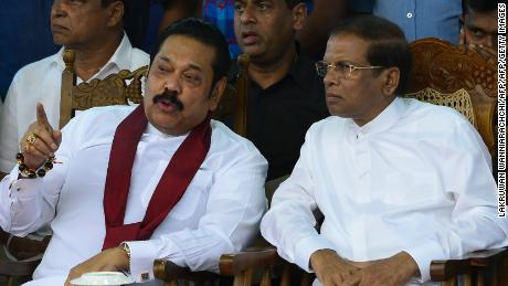 Sri Lanka's President Maithripala Sirisena (R) and disputed prime minister Mahinda Rajapaksa speak during a rally in Colombo on November 5.