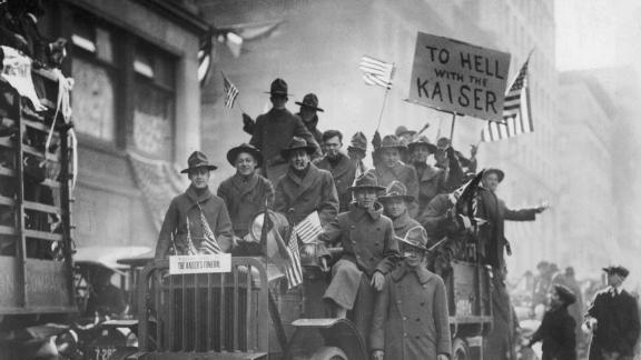 A group of American soldiers celebrate the Armistice and the end of World War I in a parade in New York City, 1918.