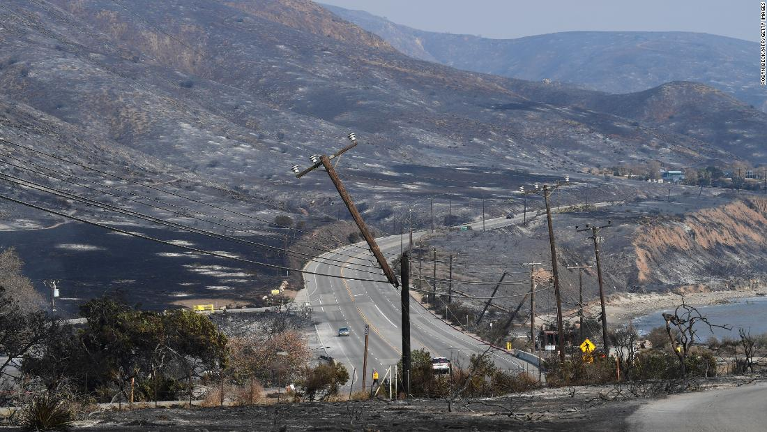 Scorched hillsides and damaged power lines are seen on November 10 along the Pacific Coast Highway in Malibu.
