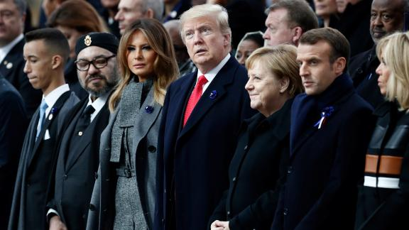 Moroccan King Mohammed VI, US first lady Melania Trump, US President Donald Trump, German Chancellor Angela Merkel, French President Emmanuel Macron and his wife Brigitte attend a ceremony at the Arc de Triomphe in Paris.