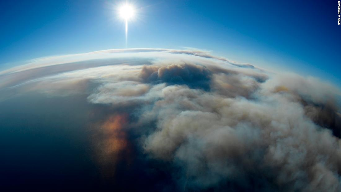 Fires burn toward the Pacific Ocean as seen Friday from a helicopter over Malibu.
