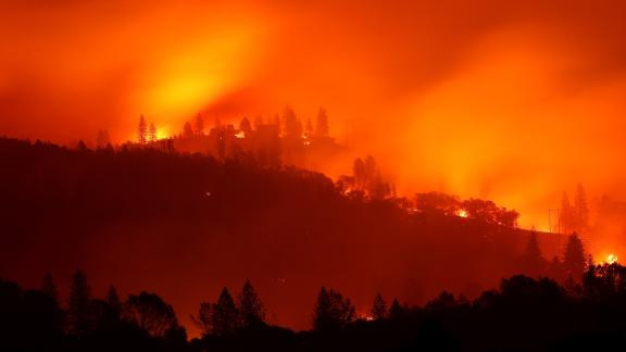 BIG BEND, CA - NOVEMBER 10:  The Camp Fire burns in the hills on November 10, 2018 near Big Bend, California. Fueled by high winds and low humidity the Camp Fire ripped through the town of Paradise charring 105,000 acres, killed 23 people and has destroyed over 6,700 homes and businesses. The fire is currently at 20 percent containment.  (Photo by Justin Sullivan/Getty Images)