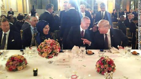 US President Donald Trump and Turkish President Recep Tayyip Erdogan sitting next to each other and chatting at a dinner hosted by French President Emmanuel Macron on November 10 2018 in Paris.