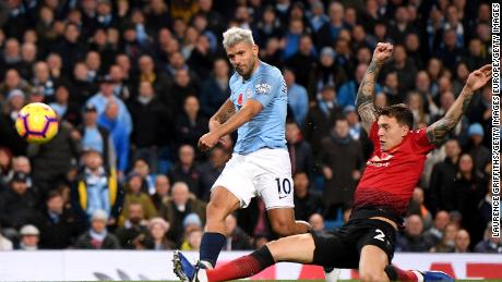 Sergio Aguero blasts home Manchester City's second goal early in the second half under challenge from Victor Lindelof of Manchester United.