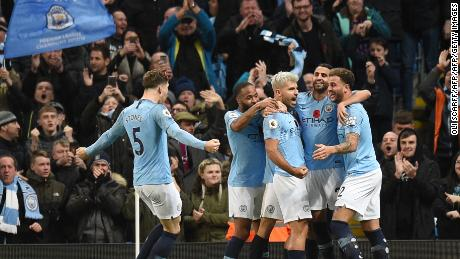 Manchester City's players celebrate Sergio Aguero's second goal at the Etihad Stadium on the way to a derby victory over Manchester United.