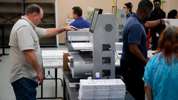 LAUDERHILL, FL - NOVEMBER 11: Elections staff load ballots into machine as recounting begins at the Broward County Supervisor of Elections Office on November 11, 2018 in Lauderhill, Florida. A statewide vote recount is being conducted to determine the races for governor, Senate, and agriculture commissioner. (Photo by Joe Skipper/Getty Images)