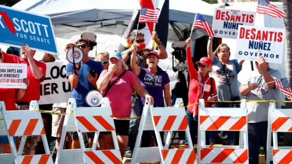 Protesters gather outside of the Broward County Supervisor of Elections office during a recount on Sunday, Nov. 11, 2018, in Lauderhill, Fla. (AP Photo/Brynn Anderson)