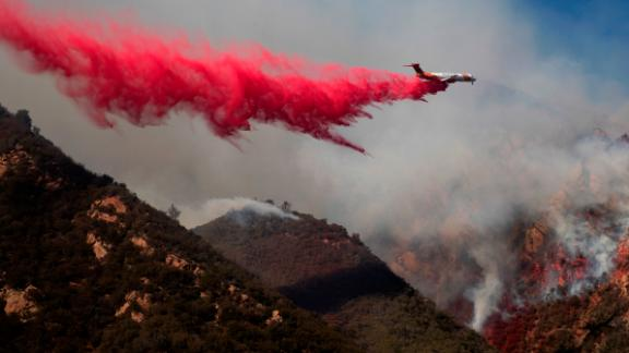 A plane drops fire retardant on a burning hillside in Malibu on November 11.