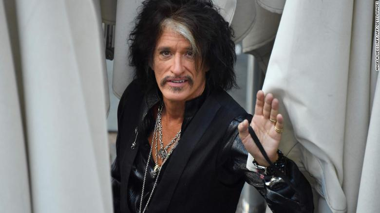 Joe Perry, shown at an August TV appearance, suffered from shortness of breath, his spokesperson said.