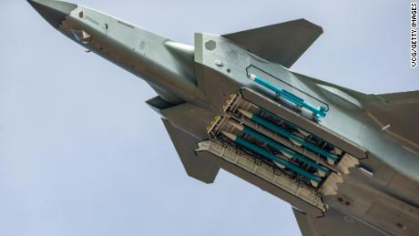 A J-20 fighter of the Chinese air force shows its load of long-range missiles at Airshow China in Zhuhai on Sunday.
