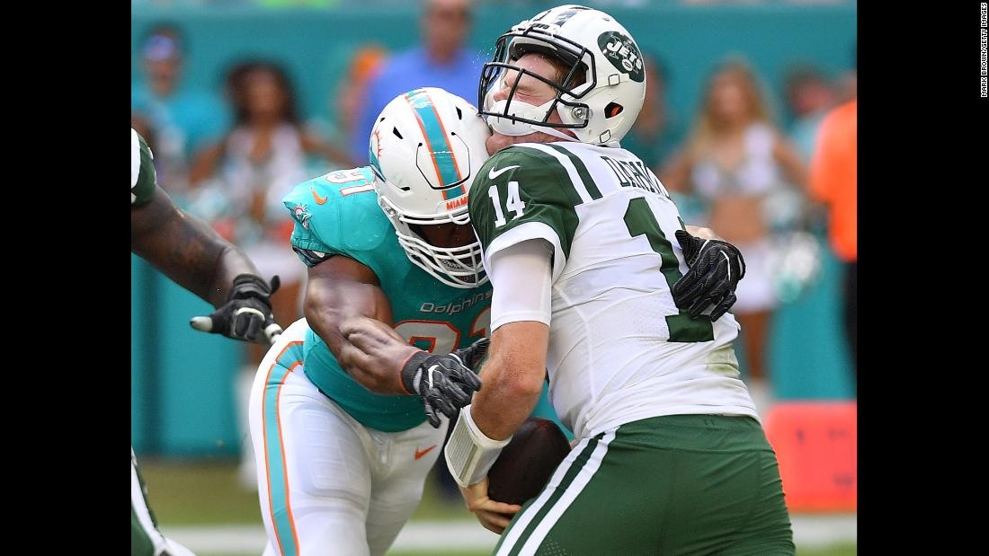 Cameron Wake of the Miami Dolphins sacks New York Jets quarterback Sam Darnold in the second quarter of their game on November 4 in Miami, Florida. The rookie QB suffered a sprained right foot in the 13-6 loss and subsequently missed Sunday's game against the Bills.